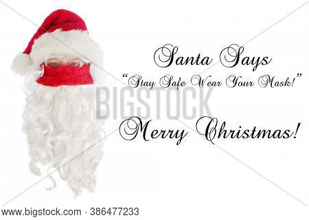 Santa Claus Covid-19. Santa Claus head wearing his Santa Hat, Glasses and a Red Velvet Face Mask. Text reads Stay Safe Wear your Mask. Isolated on white. Coronavirus is dangerous.