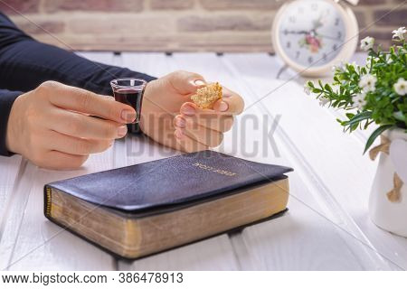 Young Woman Praying And Taking Communion  - The Wine And The Bread Symbols Of Jesus Christ Blood And