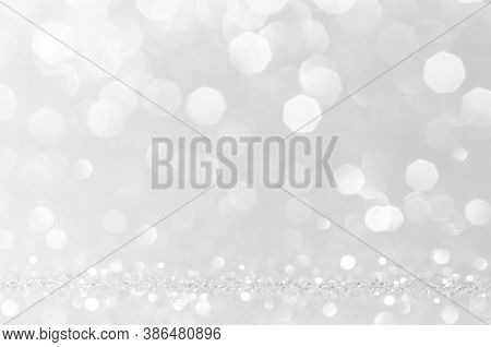 Abstract Bokeh White,light Grey,sliver Colors De Focused Circular Background.night Light Season Gree