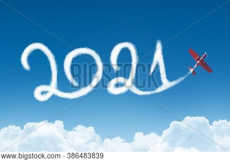Happy New Year 2021 Concept On The Background Below Cloudscape. Drawing By Passenger Airplane White