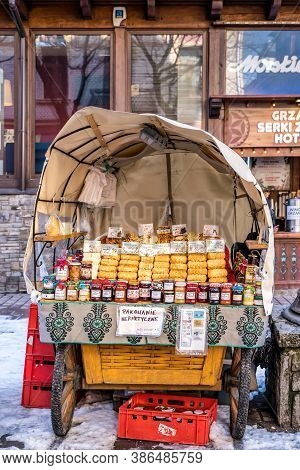 Zakopane, Poland, March 2019 Traditional Carriage With Homemade Preserves And Oscypek Cheese On Krup