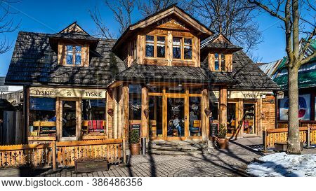 Zakopane, Poland, March 2019 Traditional Wooden Restaurant On Krupowki Promenade, Main Shopping Area