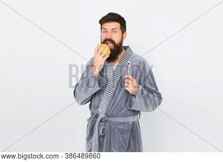 Having Healthy And Strong Teeth. Morning Routine. Personal Care In Morning. Man Hipster Bathrobe Eat