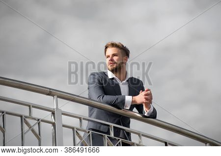 Businessman Successful Entrepreneur In Suit Walks Outdoor Sunny Day, Sky Background. Businessman Att