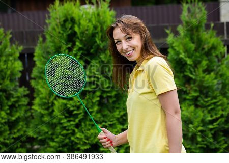 Happy Smiling Badminton Player Holding Racket In Hands. Young Fit Beautiful Woman Playing Badminton