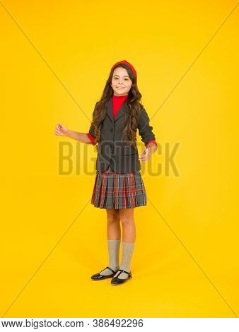 Keeping Her Smart. Happy Child Wear Uniform Yellow Background. School Dress. Formal Style. Fashion S