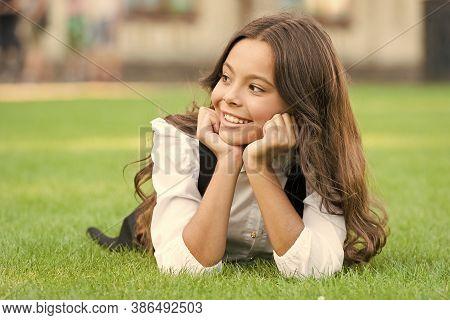 School Break For Rest. Adorable Pupil. Girl Kid Laying Lawn. Mental Wellness. Girl School Uniform En