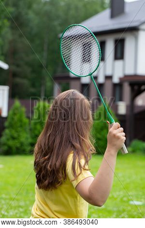 Young Fit Woman Playing Badminton Outdoors. Badminton Player Holds Racket In Action. Sport, Youth, A