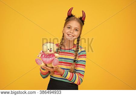 Girlish Temper. Cute But Dangerous. Halloween Concept. Small Adorable Child With Red Horns. Accessor