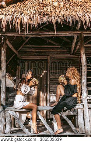 Two Beautiful Young Stylish Fashion Models Having Fun Outdoors