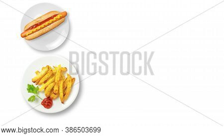 Top View Of Fast Food Dishes. Hot Dog And Fries Isolated On A White Background With Copy Space. Unhe