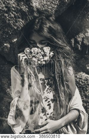 Beautiful Young Woman Cover Her Face With Flowers. Black And White Portrait. Conceptual Tilt Shift E
