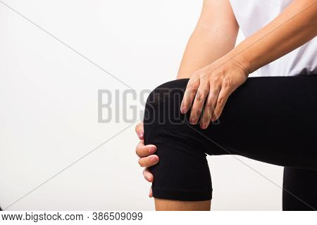 Closeup Young Woman Aches To Suffer From Pain Knee And She Uses Hand Joint Hold Knee Agony, Studio S