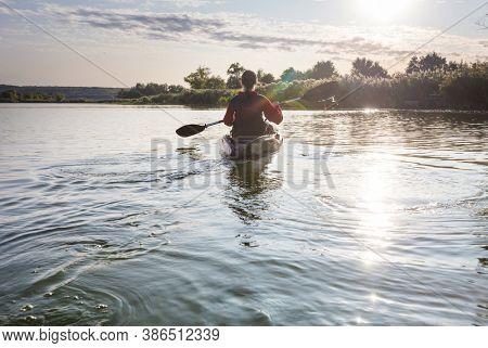 kayaking in river in the summer season