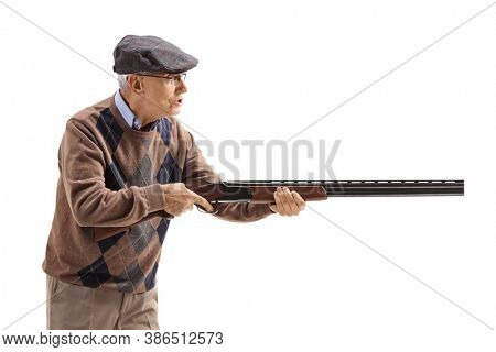 Angry old man aiming with a shotgun isolated on white background