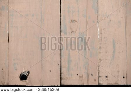 natural wood background painted in light red brown color, old plank, weathered and scratched, highly detailed photo