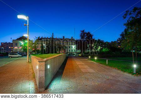 Park at the starosty building in Pruszcz Gdanski at night, Poland.