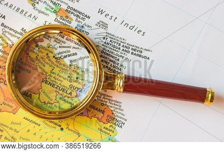 Venezuela And Other Countries  On A Map Of  South America  In A Defocused Magnifying Glass, The Them