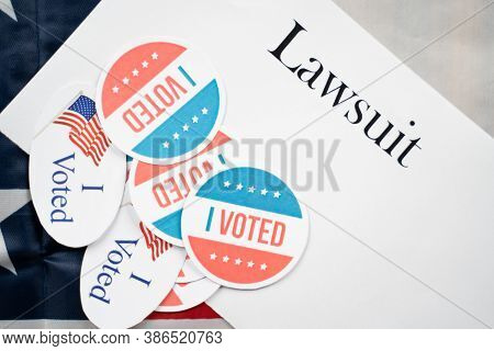I Voted Stickers On Lawsuit Paper With Us Flag As Background - Concept Of Lawsuits In Usa Election.