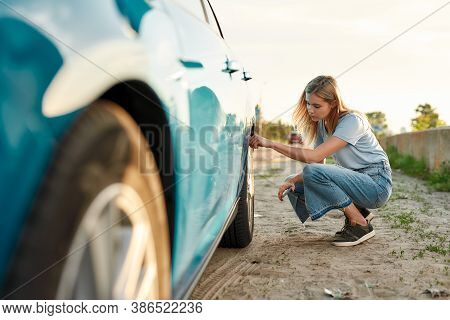 Attractive Young Woman Checking Air Pressure Of Car Tire On Local Road Side While Traveling, Girl Ha