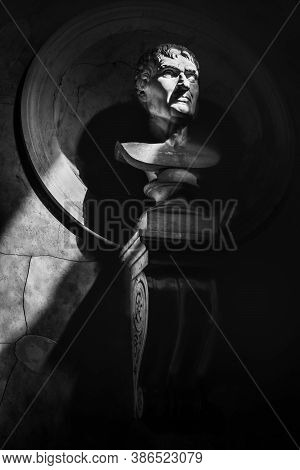 Half-length Statue Portrait Black And White Vertical Background In The Dark With Sunrays Filter Thro