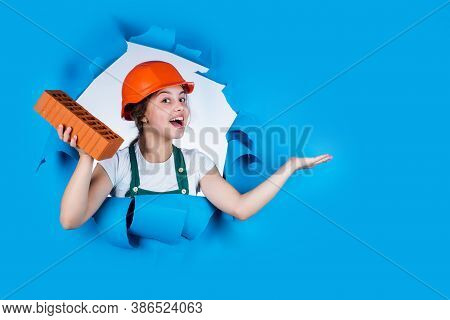 Building A House. Kid Build Construction. Engineer Teen Is Construction Worker. Professional Craftsm