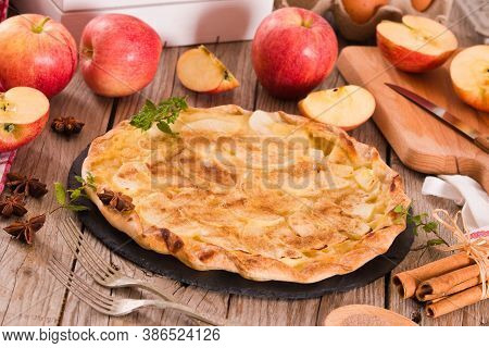 Apple Tart With Sugar Cinnamon Topping On Wooden Table.