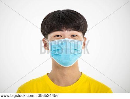 Close Up Portrait Of  Teenage Asian Boy Wear Medical Mask