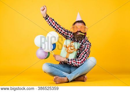 Event Manager Poses With Festive Accessory. Fun And Happiness Concept. Happy Man Holding Colorful He