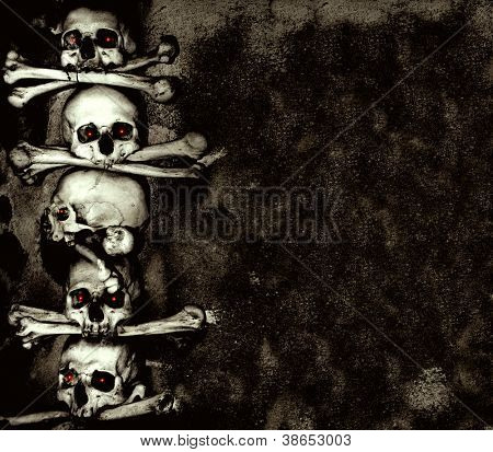 Grunge background with human skulls and bones