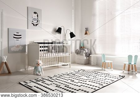 Cute Baby Room Interior With Crib And Decor Elements