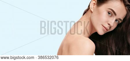 Softness. Beautiful Face Of Young Woman With Clean And Fresh Skin. Flyer With Copyspace For Ad. Conc