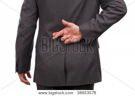 Businessman with his fingers crossed behind his back - concept for good luck or dishonesty