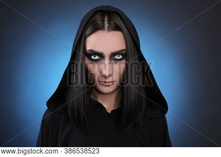 Mysterious Witch With Spooky Eyes On Color Background