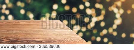 Wooden Table Top With Abstract Blur Christmas Tree With String Light Background With Bokeh Light,win