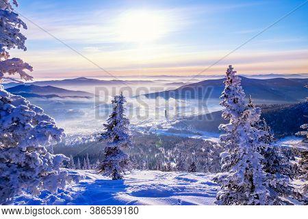 Sheregesh Kemerovo Region Ski Resort In Winter Dawn Sun On City, Landscape On Mountain And Hotels, A