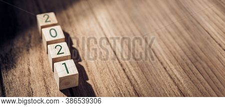 2021 Happy New Year On Wood Block On Wood Table And Concrete Wall With Sunlight From Window.hope New