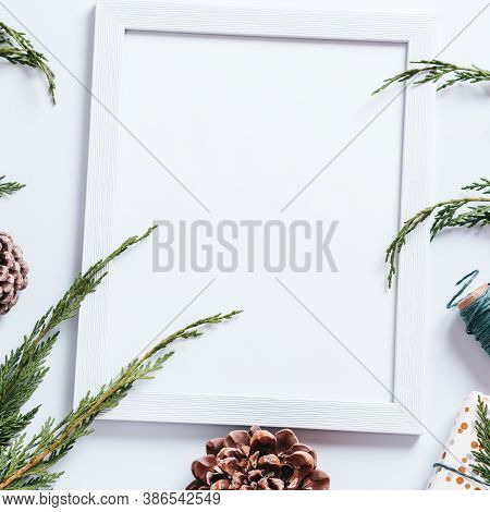 Christmas Frame With Pine Cones, Cedar Branches, Presents And Decorations. Christmas Mockup, Copy Sp