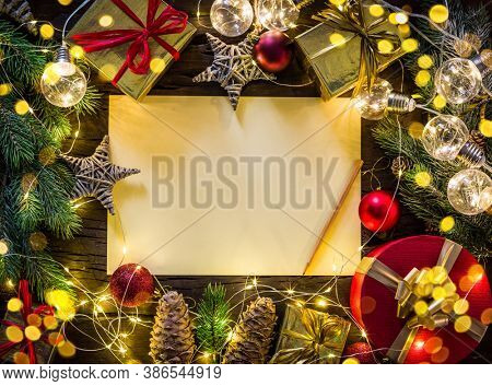 Empty Santa paper letter and christmas decoration around it. Christmas or New Year holiday background. Top view.