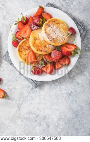 Sweet Cottage Cheese Pancakes On Plate Served Strawberries. Russian Syrniki, Ricotta Fritters Or Cur