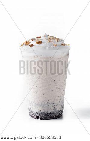 White Chocolate, Vanilla And Nuts Iced Milkshake Isolated On White Background