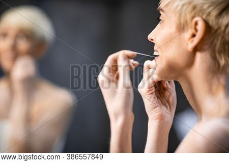Toothcare. Unrecognizable Woman Flossing And Cleaning Teeth Preventing Cavity Doing Morning Routine