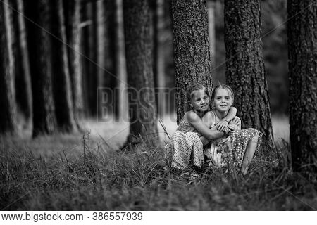 Two little friends in the park. Black and white photography.