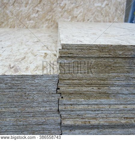 Osb Background, Dense, Seamless Surface. Osb Sheets Are Stacked In A Hardware Store. Building Materi