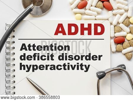 Page In Notebook With Adhd Attention Deficit Hyperactivity Disorder On White Background With Stethos