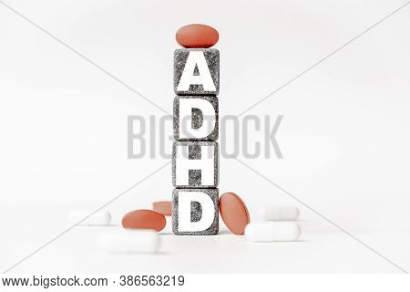 A Group Of White And Red Pills And Cubes With The Word Adhd Attention Deficit Hyperactivity Disorder