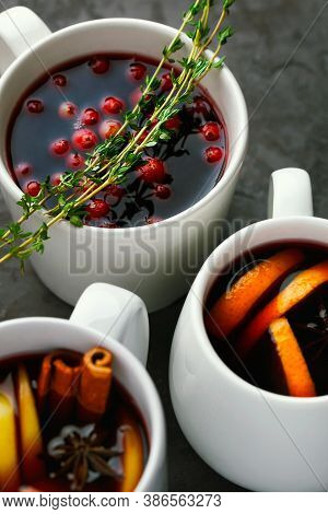 Christmas Hot Mulled Wine Or Gluhwein Drink In A Cups With Orange Citrus,apple,cinnamon And Stars An