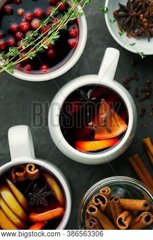Christmas Hot Mulled Wine Or Drink In A Cups With Orange Citrus,apple,cinnamon Sticks And Stars Anis