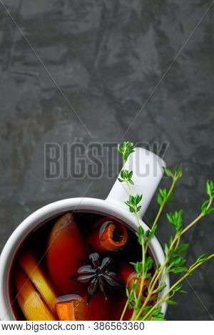 Christmas Hot Mulled Wine Or Gluhwein Drink In A Cup With Citrus,apple,cinnamon Sticks And Anise On