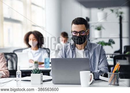 Office Center Workers Are Protected From Virus Outbreak During Covid-19 Epidemic. Young Hipster Man